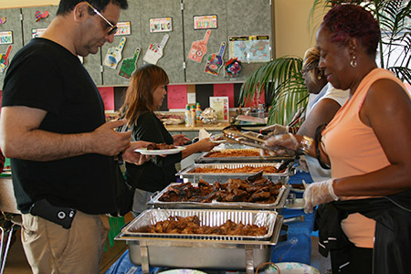 SFPD National NIght Out people serving food to community