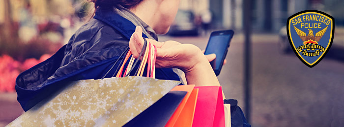 Safe Shopper Tips header with image of Woman holding shopping bags while looking at her cell phone on the street