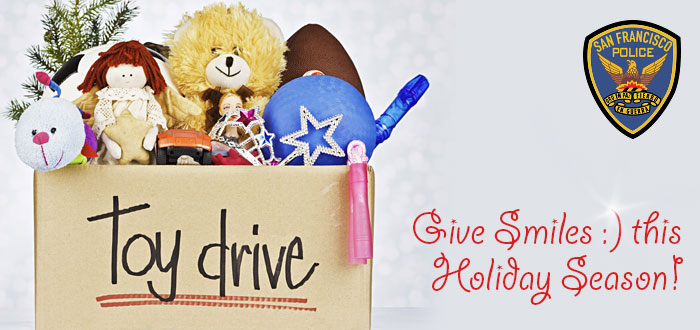 "SFPD Toy Drive header with image of box of toys and text ""Give Smiles this Holiday Season"""