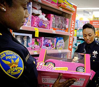 SFPD Female Officer holding pink Barbie car