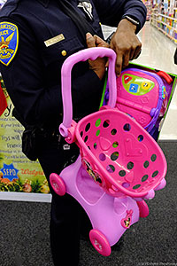 SFPD Officer holding pink shopping cart