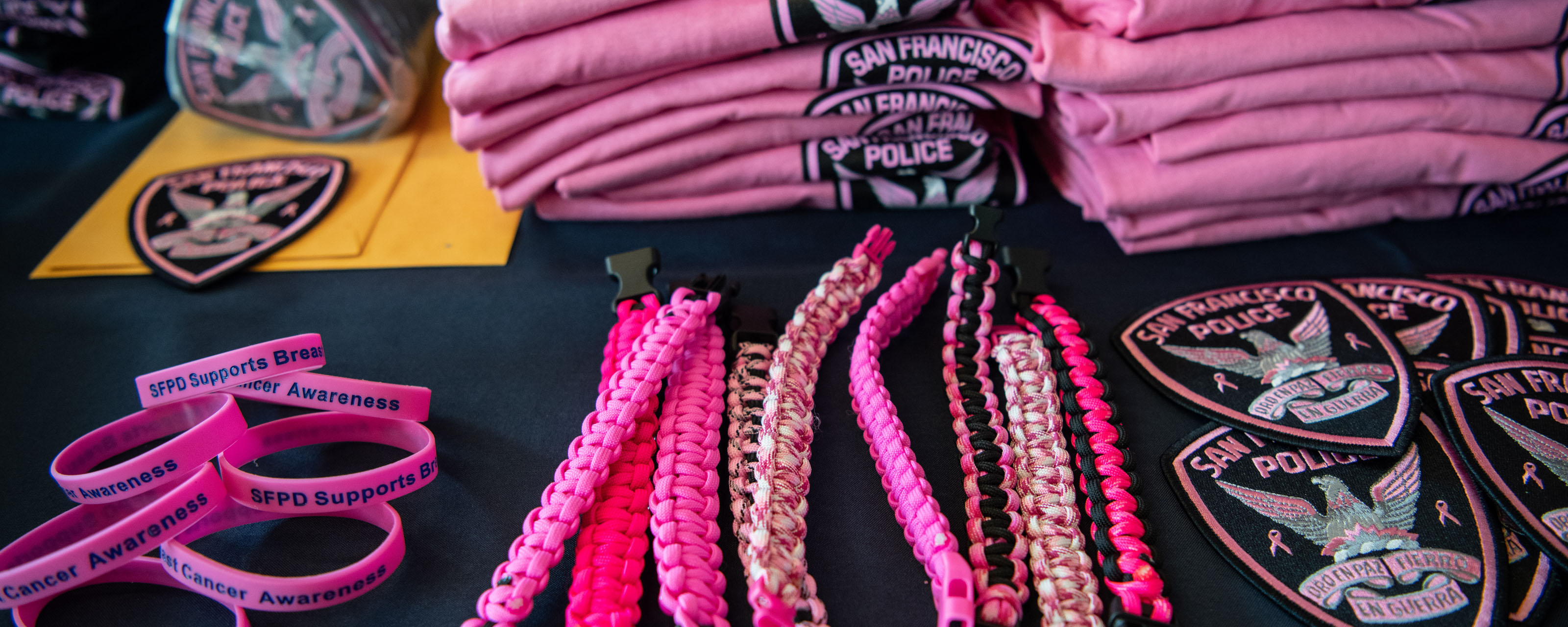 SFPD Pink Patch T-shirts, Pins and Bracelets