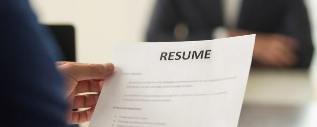 Man holding resume at job interview