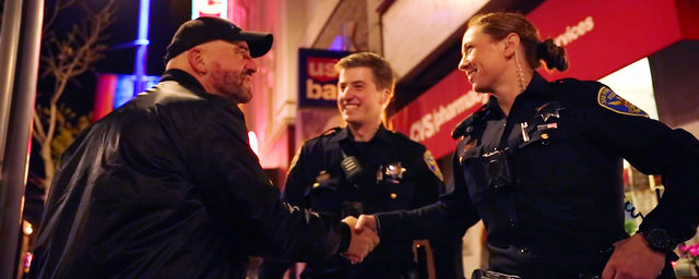SFPD Female and Male Officer Shaking Hands with Man On Street